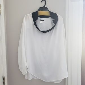 white, flowing, shirt with black framed collar